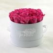 Стабилизированные розовые розы в круглой коробке 14 шт.
